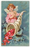 012720 LOVELY ANTIQUE VALENTINE CUPID WITH CORNOCOPIA OF HEARTS CIRCA 1906