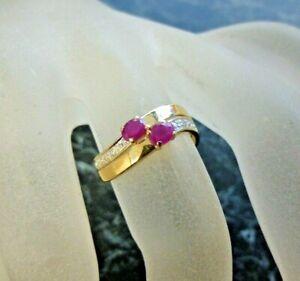 Bague or 18 K sertie rubis et diamant  poincon tete d aigle   T 54
