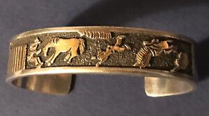 Sterling Silver and 14 K Navajo Storyteller Bracelet signed A H