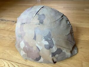 Original two sided 1968 dated Vietnam war used M-1 combat helmet cover