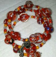 New Memory Wire Bracelet With Red/Orange toned glass beads Beads Handmade