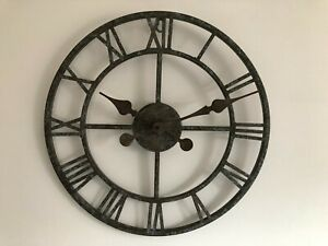 wall mounted metal skeleton clock with roman numerals .40cm dia.
