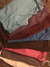 Bundle of scrub tops and bottoms Sizes Small and Medium