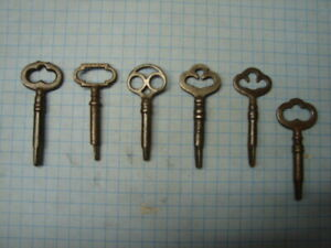 6 SEWING MACHINE KEYS -5 TRIANGLE ENDS - 1 - SQUARE