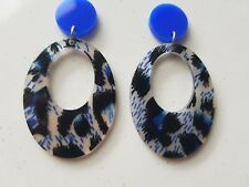 Go wild animal print blue dangle statement earrings blue top