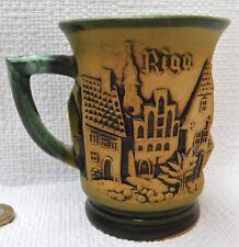 Studio pottery relief mug Riga Latvia town view European souvenir ceramic cup