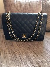 CHANEL Maxi Classic handbag Grained Calfskin and Gold Tone Metal Black