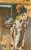 Linen Postcard I059 Pueblo Indian San Ildefonso Black Pottery Man Holding Pot