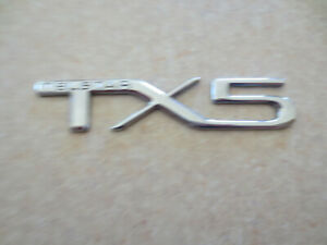 Original Ford Telstar TX5 plastic car badge