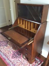 Vintage wooden bureau with glazed bookshelf above.