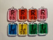 Four sets of xray markers with initials 4 R and 4 L