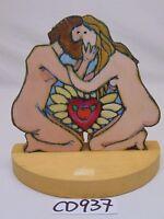 PAINTED 1970'S ART BY HUNTER FOLK ART ON CUT WOOD PAINTED ADAM & EVE KISSING