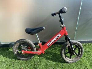 Strider balance bike Red