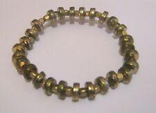 Lovely gold tone metal industrial feel beaded bracelet elasticated steam punk