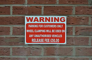 PARKING CUSTOMERS ONLY WHEEL CLAMPING UNAUTHORISED VEHICLES £50 sign or sticker