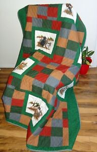 Earth tone hunting dog theme quilt with 9 by 11 inch panels