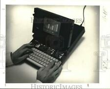 1982 Press Photo Grid System's briefcase size compass computer. - hpa00901