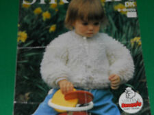 knitting pattern for  baby's loopy cardigan size 21 and size 22