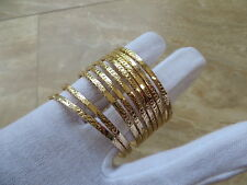 14k Gold Child Petite Slip On Bangle Bracelet set of 9 bracelets.