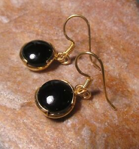 Sterling silver with 18k gold plate 9mm cabochon black onyx earrings.