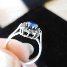 SILVER DRESS RING WITH OVAL BLUE CRYSTAL & SMALL WHITE CRYSTALS. STAMPED 'SILVER