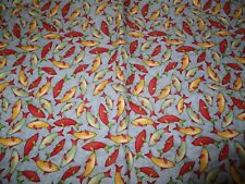 1/2 yard light blue with red, yellow and green fish Fabric