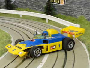 AURORA AFX / S-G-Plus   McLAREN F1   yellow - blue #1   NO SCOOP   NEW   VHTF!!!