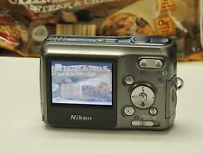 Nikon Coolpix L2 6MP Digital Camera 3x Optical Zoom Lens, 2GB SD Card, Batteries