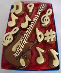 Hand-made chocolate electric guitar & musical notes