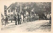 RPPC INDIANS WITH AMERICAN FLAG UMBRELLA MILITARY REAL PHOTO POSTCARD (c. 1920)