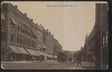 POSTCARD ONEONTA NY/NEW YORK MAIN ST BUSINESS STORE FRONT WITH TROLLEY CARS 1907
