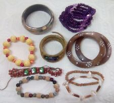 Lot of 10 wooden bracelets. Purple, yellow, green, brown. bangle + stretch