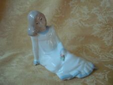 ENRIQUE G. NADAL Figurine SITTING GIRL With Rose Last Fire Date-Dec. 31, 1988