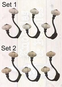 Set of 3 black iron hooks with white or cream ceramic knobs. Choice of sets.