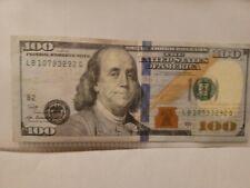 Misprinted 100 dollar bill