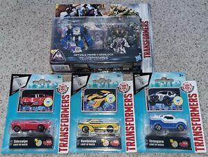 Brand new. Official Hasbro Transformers bundle Optimus Prime Bumblebee Grimlock
