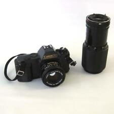 Vintage Canon T50 Camera With FD 50mm 1:1.8 and Zoom Lens 70 to 210mm 1:4