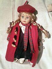 tres jolie poupée porcelaine - tenue hiver rouge