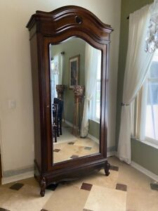 Beautiful Linen Cabinet/Armoire/Wardrobe with Mirror and hidden drawer.