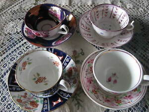 FOUR COLOURFUL JAPANESE TEA  CUPS & SAUCERS