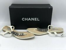 CHANEL WHITE PATENT LEATHER CC MEDALLION COINS FLAT T-STRAP SANDALS