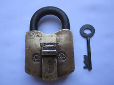 An old solid brass padlock or lock with key nice carving and unusual shape
