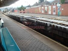 PHOTO  LOAD OF CONCRETE SLEEPERS PASSING THRO CAERPHILLY RAILWAY STATION