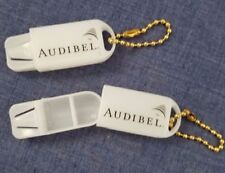 Two Hearing aid battery or pill holder key chains