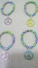 RAINBOW STARDUST LOVE & PEACE FOUR CHARM BRACELETS.