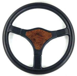 Genuine Momo Jaguar 380mm black leather steering wheel with wood centre pad. 7E