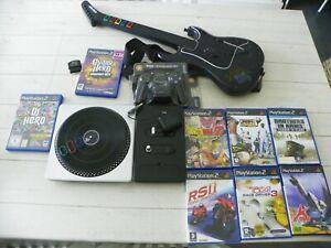 Lot 9 Jeux PS2 :  DJ Hero platine + Guitar Hero guita + 7 jeux divers+ manette