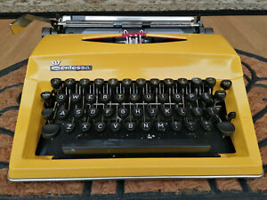 Beautiful lemon yellow Contessa portable vintage typewriter with case