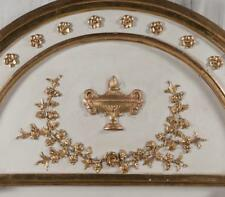 Empire style decorated and gold gilt mirror with arched top and urn a. Lot 202