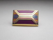 DUCHAMP LONDON  GILT AND ENAMEL MODERNIST DESIGN LAPEL PIN.